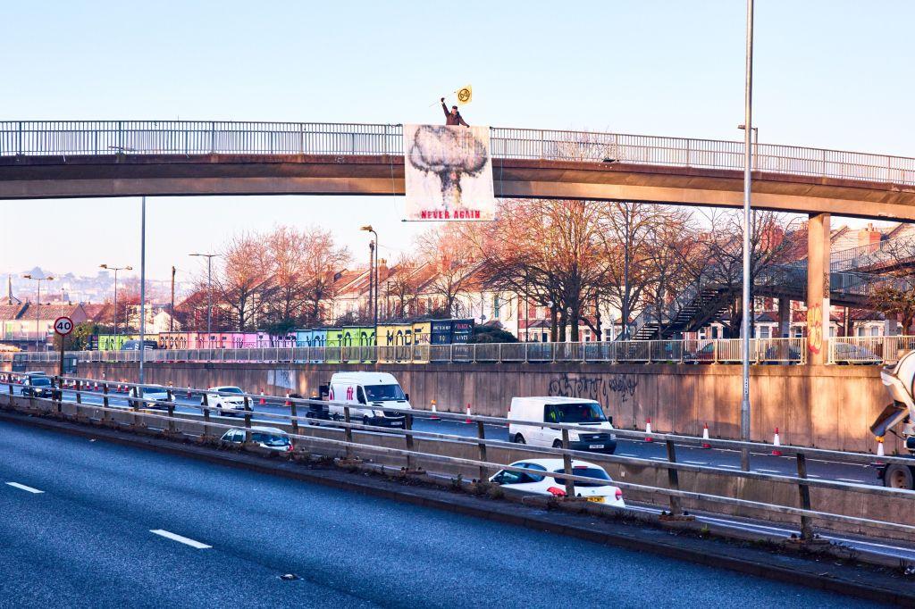Row's banner drop from the M32 footbridge.