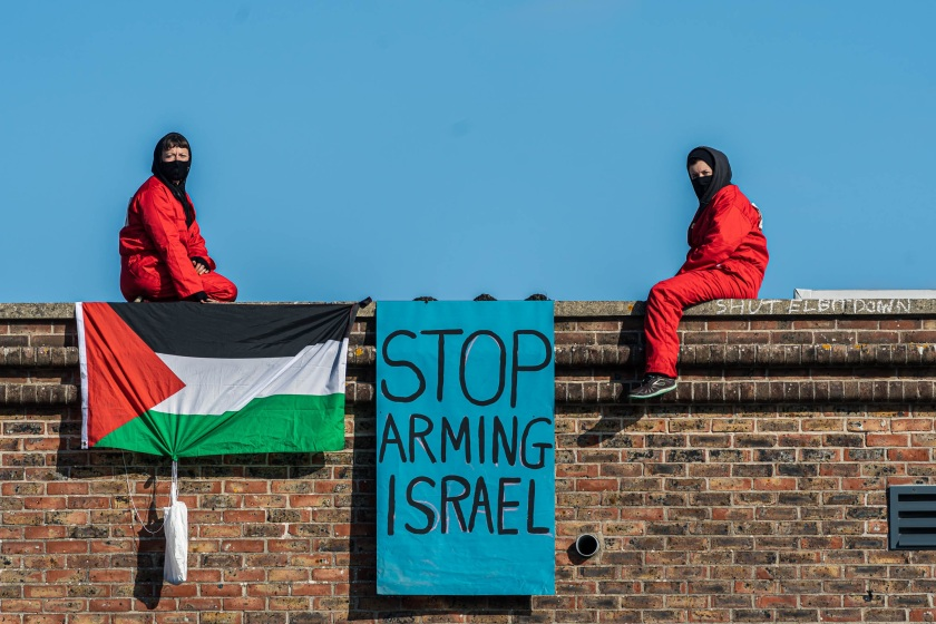 Two protesters sit on rooftop of Bristol's Elbit offices.