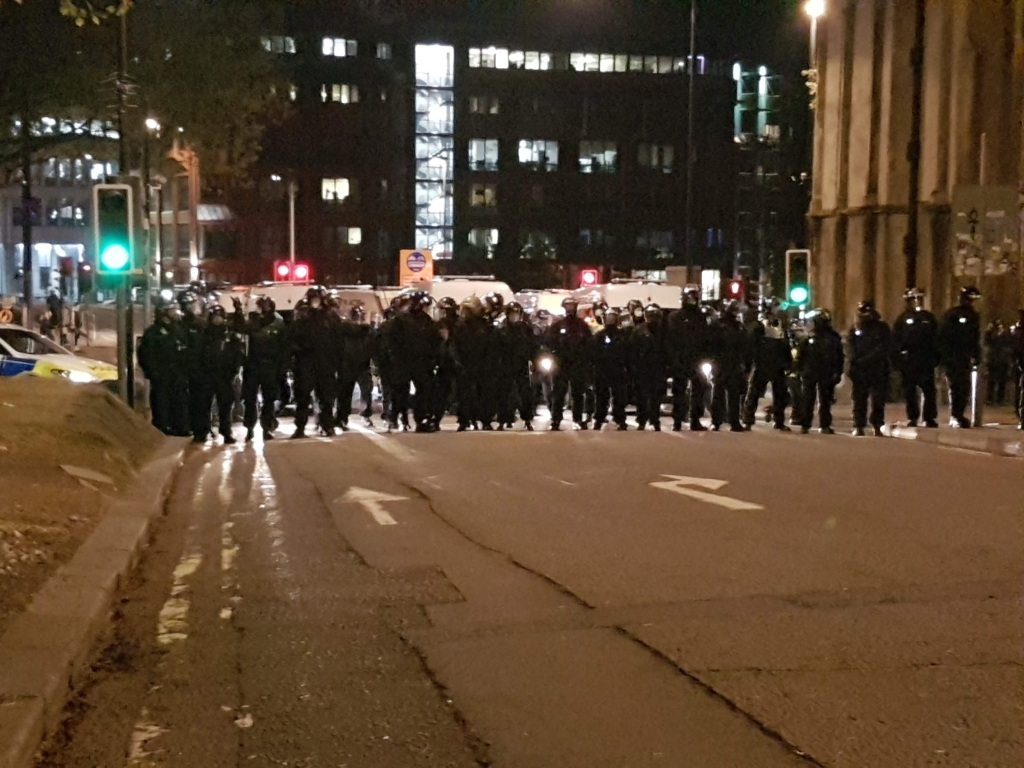Riot police lined up on High Street