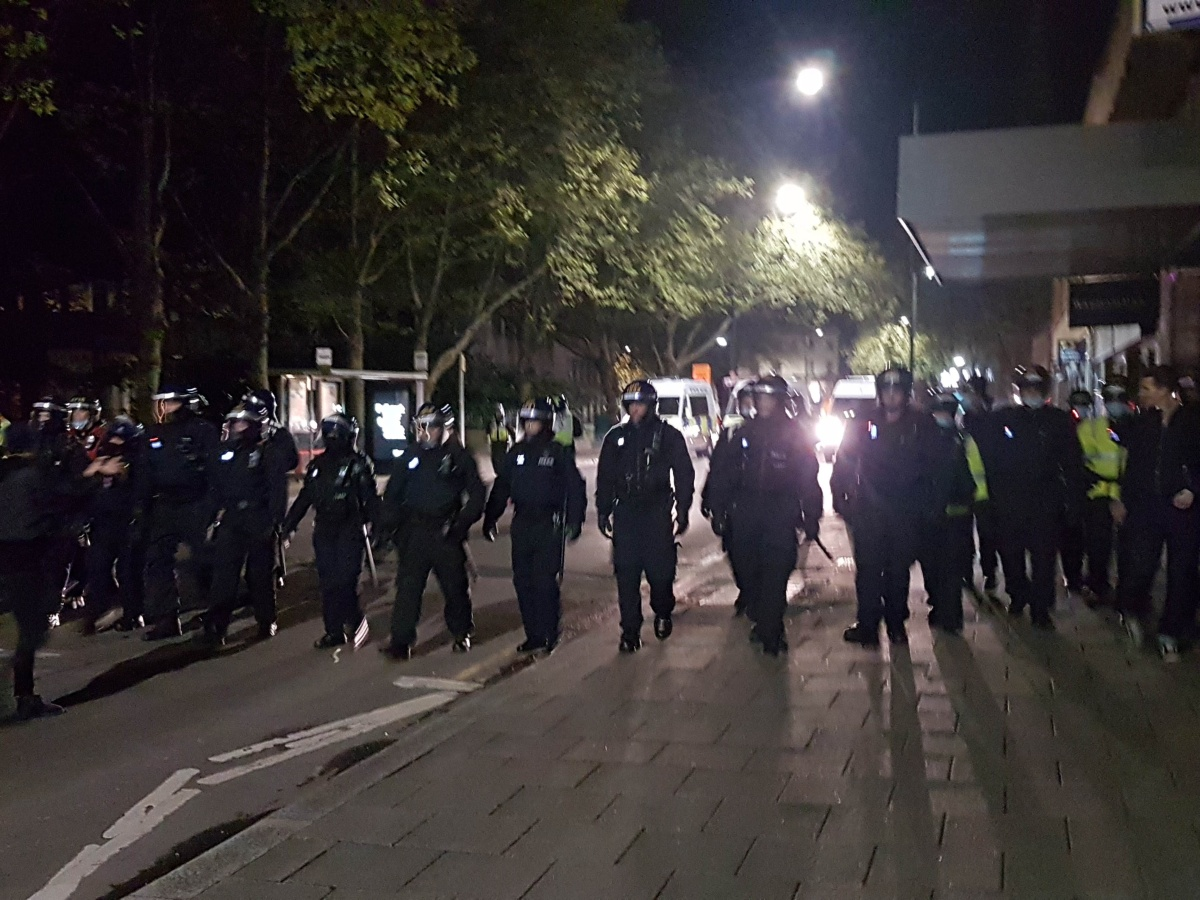 Riot police advance along Wine Street
