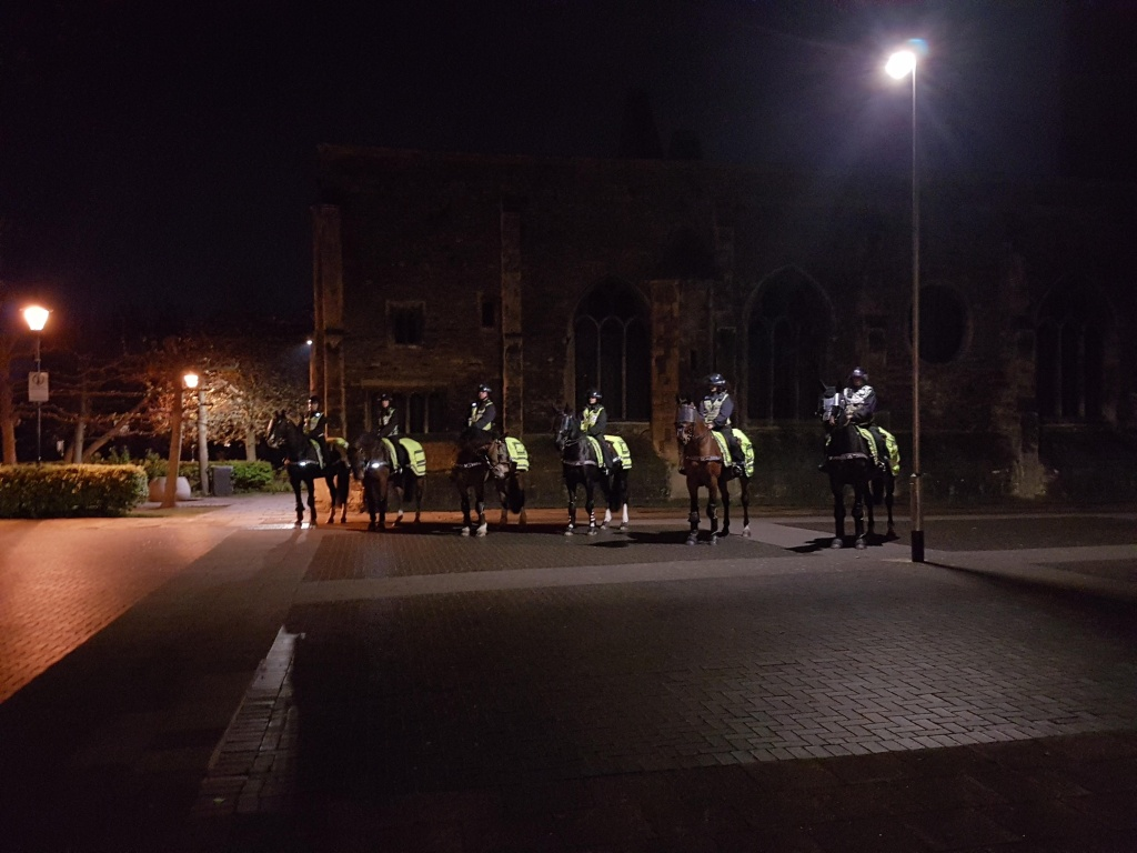 Six mounted police stand by in Castle Park.