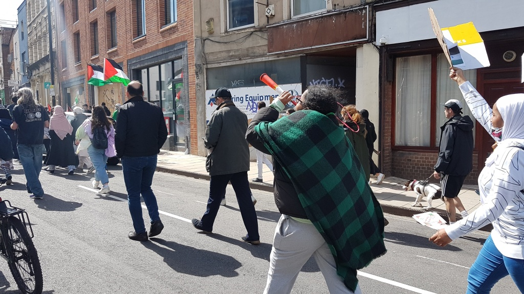 Protester blowing on a horn.