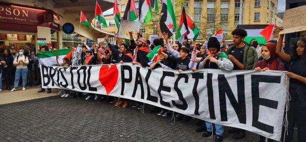"Crowd holds a banner reading ""Bristol [love heart] Palestine"""