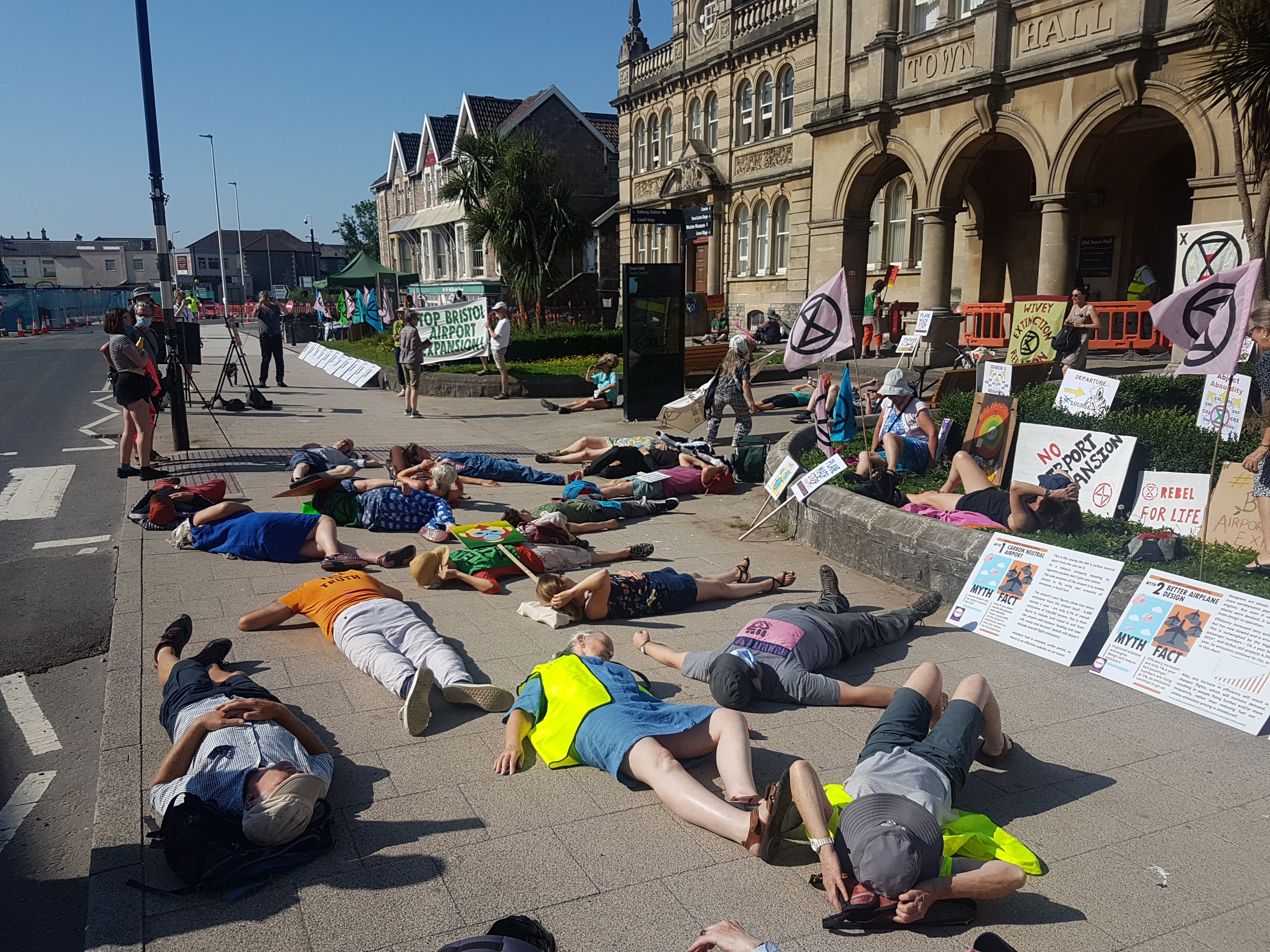 A dozen people lie on the floor pretending to be dead in protest.