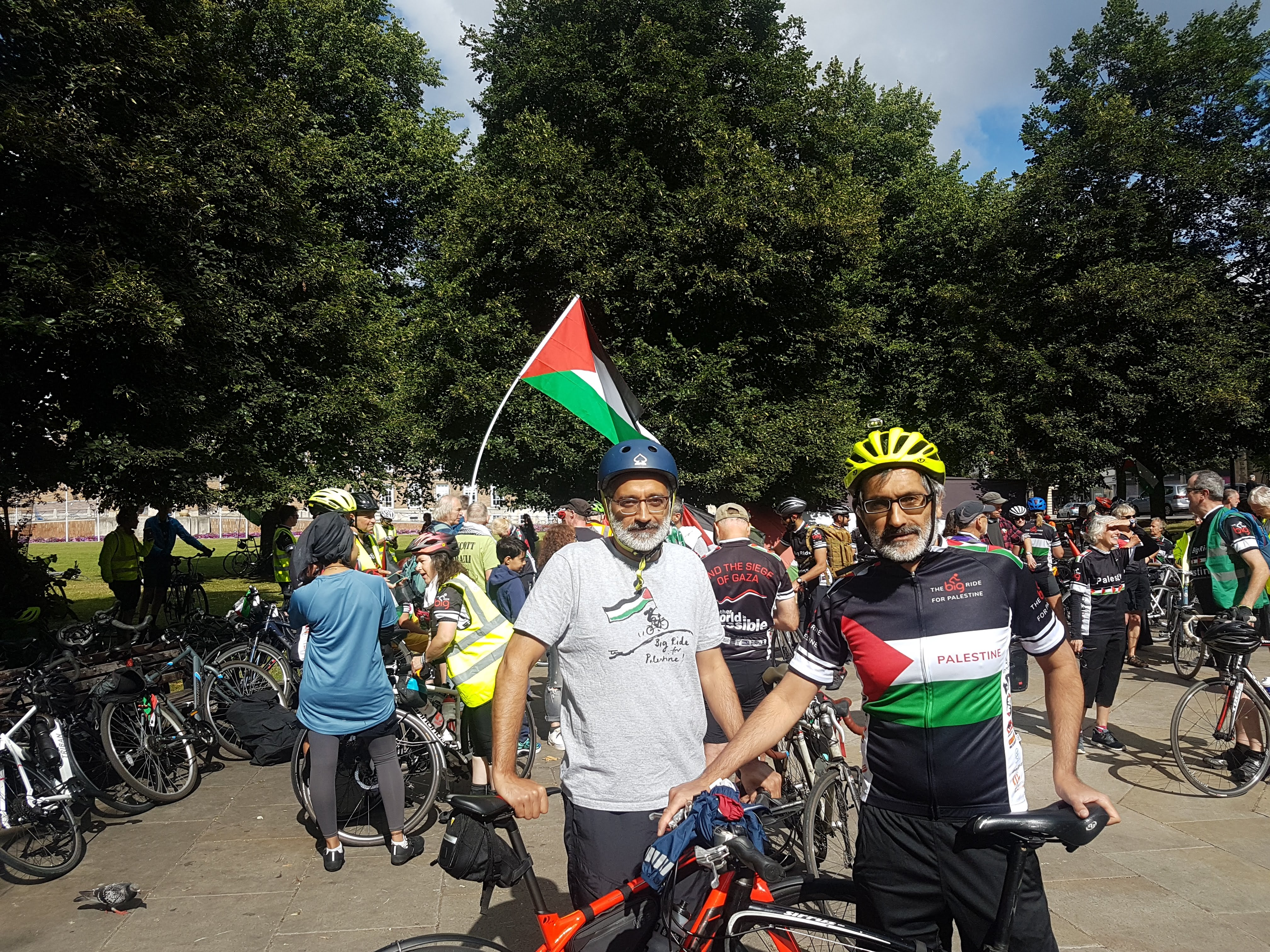 Two cyclists stand with their